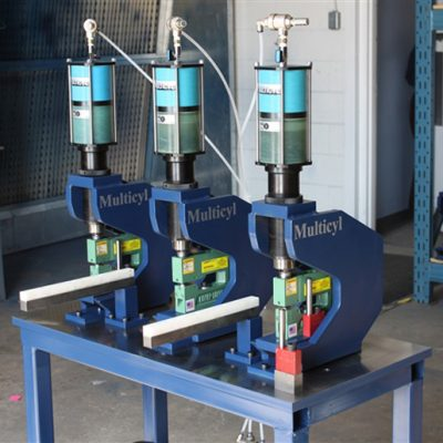 UniPunch Units in a Hydraulic Air over Oil Press System - The air over oil Multicyl® press system is an alternative to presses and press brakes. Here is a three hole punch setup using UniPunch tooling in a Multicyl® table-top press system.