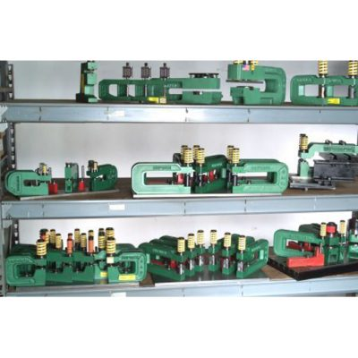 Quick Change Tooling - Quick Change Tooling: Here dedicated setups of UniPunch tooling are shown on storage shelves. UniPunch can design dedicated setups for your parts. Using dedicated setups of UniPunch tooling you can have both faster changeover at the press and faster processing time.